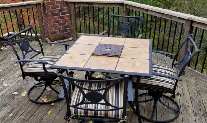 Fantastic patio set, wrought iron tiled table and four swivel chairs with cushions