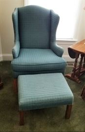 Blue upholstered chair and matching ottoman