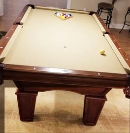 Very well cared for Brunswick Glen Oaks 8 foot, slate, pool table. Four pool cues and various accessories. Brunswick Ping pong table top also available.