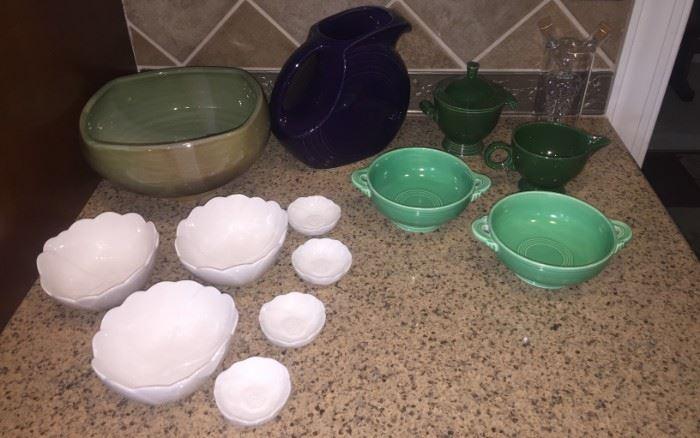 Handmade pottery decorative bowl, Martha Steward flower nesting bowls, purple Fiesta-ware pitcher, deep green Fiesta-ware creamer and sugar set, light green Fiesta-ware soup bowls