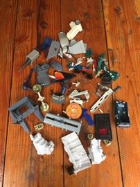 Various Star Wars toy parts