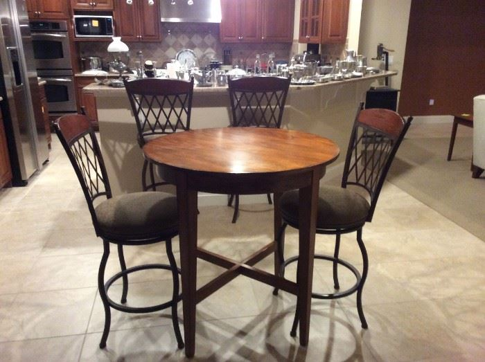 """High top bar table and two table height stools, additional 2 counter height stools in background! Measures 37"""" x 36"""""""