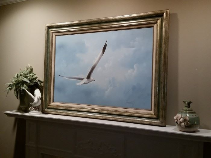 Framed oil painting of a soaring seagull.