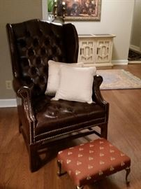 Small tufted wing back style 'Naugahyde' chair with brass nail trim. No tears, or stains, great condition.