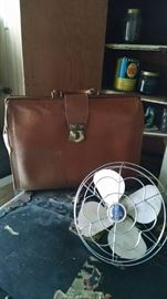 vintage fan and leather bag