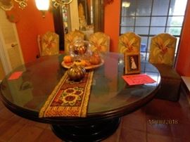 Dining table & 6 chairs.     Wedding dress (in box).  Pictured in frame on table.