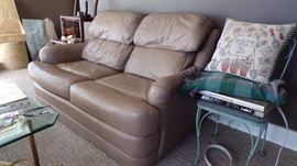 Leather Love Seat, Metal Table , Cushion, VCR, Afgan