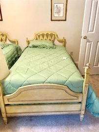 One of two twin size beds