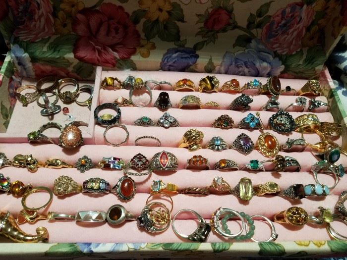 Many, many primarily costume jewelry but also sterling rings with stones