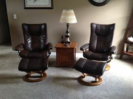 Matching stress less brown leather chairs and ottaman