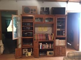 Stereo equipment and name brand speakers, reel to reels, cookbooks, vhs tapes and more books, beautiful oak and glass cabinet