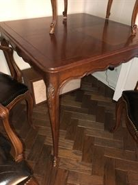 Kindel Louis XVI Style walnut game table with five matching open armchairs with leather seats and can backs
