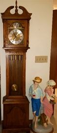 Grandmother clock & boy & girl cast figurine