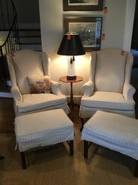 Slipcovered linen wing back chairs. Priced individually.