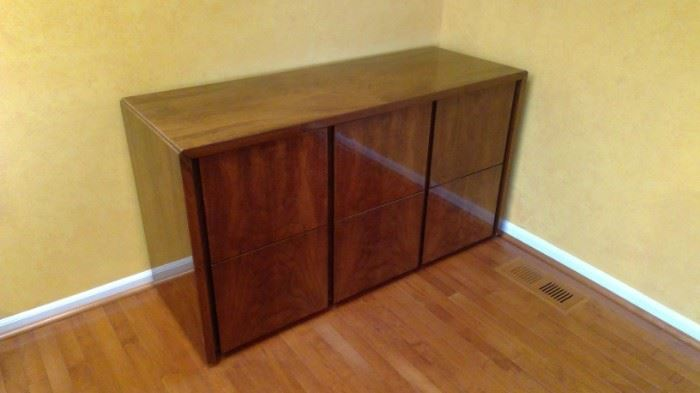 A 6 drawer wooden file cabinet.   55 width x 20 depth x 30 height.  Excellent condition.  Beautiful piece