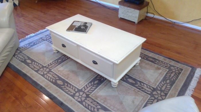 Coffee table and rug.   Table is 45 width x 24 depth x 18 height.    Rug is 5' x 8'