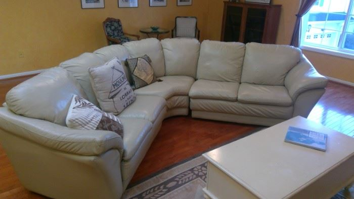 3 piece leather sectional.  Slight wear.  A great full sized piece.