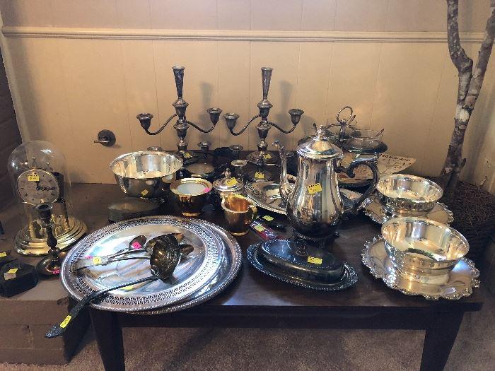 Antique silver tea set, platters, bowls, candelabras