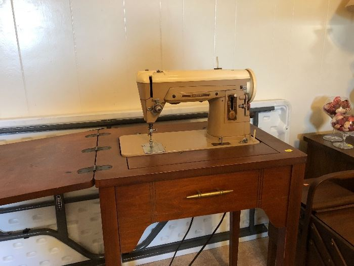 Antique sewing machine as sewing g table