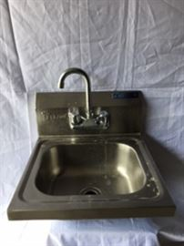 Stainless Steel Sink by L&J NY With a Tall Faucet