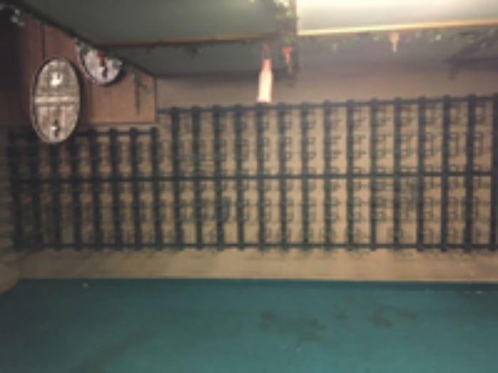 Wall mounted wine racks with adjustable shelves.