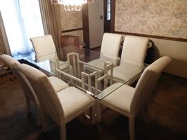 glass  top dining  room  table  and  white  chairs