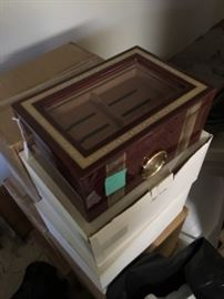 Large, multi-layered humidor with hygrometer and glass display top.
