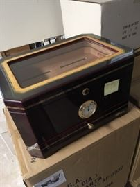 Mahogany and glass humidor with hygrometer.  Three levels of cigar storage with pre-seasoned interior.