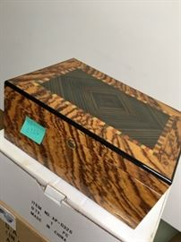 Tiger wood humidor with multiple layers of storage.  The Hygrometer is on the inside of this humidor, which is also pre-seasoned and ready for immediate use.