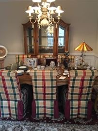 Elaborate Schnadig dining room table, chairs and china cabinet.  This matching set comes from the manufacturer Schnadig and is in like-new condition.  The china cabinet has built in lighting, and the table comes with two leafs.