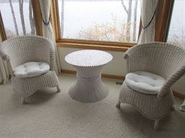 Pair of wicker chairs and interesting table.
