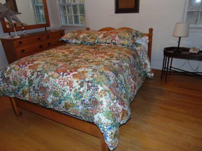 Curly maple.  Bedding not included, but mattress is