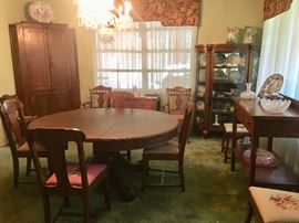 Dining Room - tiger oak table with 5 leaves, 6 needlepoint chairs, china cabinet and sideboard