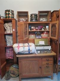 Other side of sewing room. Huge collection of rustic cabinets of all sizes.
