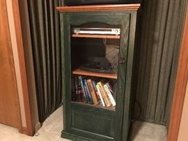 Glass front storage cabinet with 4 shelves.