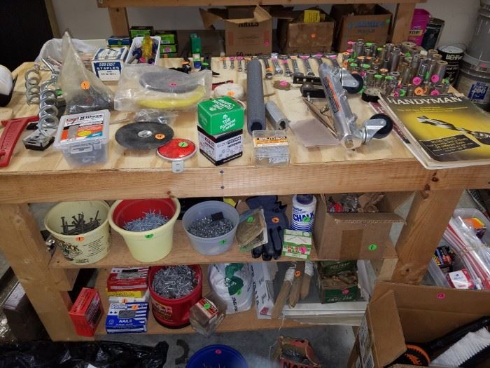 Hand tools, more screws and nails, etc., and another work bench for sale...