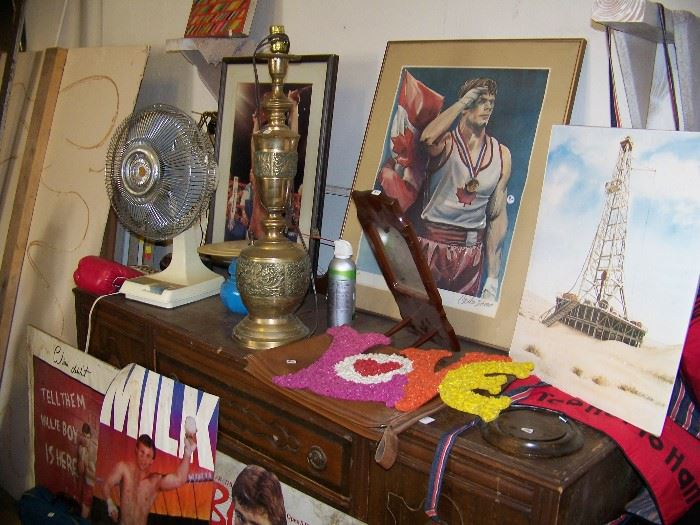 Small buffet, posters and lamp.