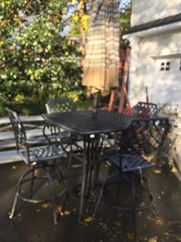 VERY NICE CAST IRON PATIO SET WITH COUSHIONS AND UMBRELLA