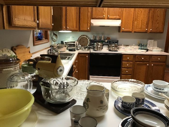 Kitchen getting set up, pots pans, Pyrex, sunbeam mixer....
