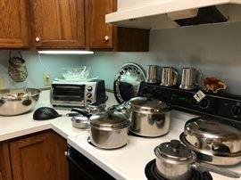 Kitchen getting set up, pots pans, Pyrex, sunbeam mixer, toaster oven....