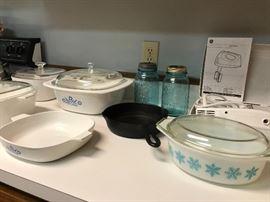 Kitchen getting set up, pots pans, Pyrex, sunbeam mixer....