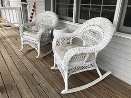 Pair of white wicker rocking chairs