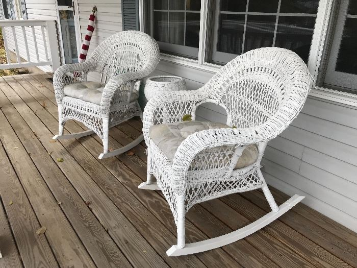 Pair of white wicker rocking chairs