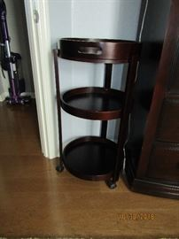 SMALL END TABLE WITH 3 SHELVES AND THE TOP COMES OFF AS A SERVING TRAY