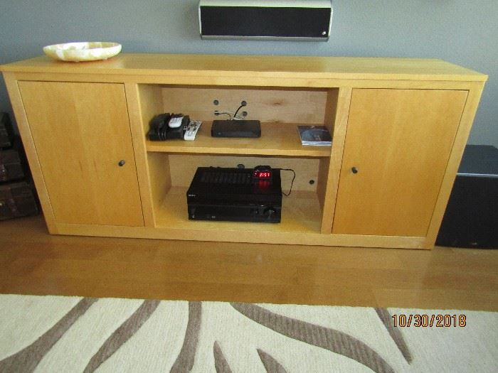 """CONTEMPORARY CREDENZE.. IT IS CALLED """"ROOM AND BOARD"""" 70X17X30 2 SIDES WITH ADJUSTABLE SHELVES, CENTER IS ONE ADJUSTABLE SHELF.. HOLDS A LOT OF ELECTRONIC EQUIPMENT.. HOLES RE ALREADY PRE-DRILLED FOR NO MESS.."""