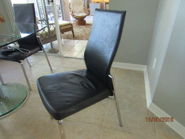 4 ALL LEATHER BLACK AND CHROME CONTEMPORARY DINING CHAIRS WITH FALL BACK FOR CONVENIENCE..SCAN DESIGN
