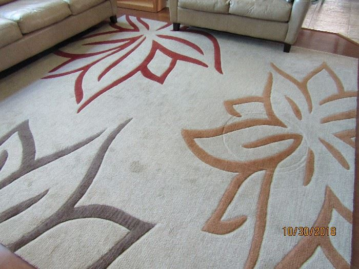 10 FT  SQUARE DALYN RUG CO.  ABSTRACT DESIGN CREAM BASE WITH 3 COLOR OF DESIGN..