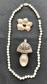 Pearl Necklace, Sterling E. Levine Flower Pin, and Rebecca Collins Slide