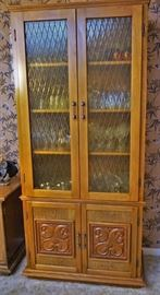 Two custom cabinets made by the homeowner