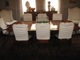 Set of 8 Queen Anne dining chairs.  Covers lift off easily.